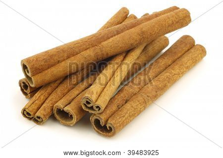 dried cinnamon sticks on a white background