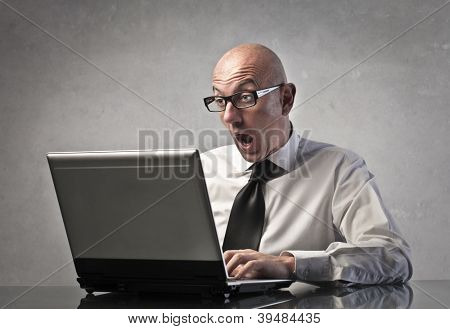 A man is surprised while using a computer
