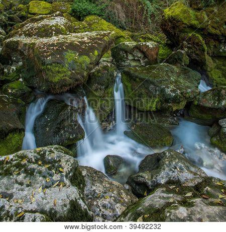 Stream running between rocks in  Fontaine-de-Vaucluse, France