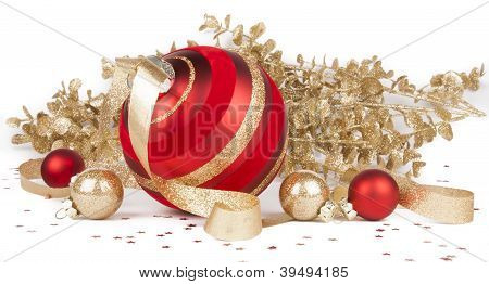 Christmas ornaments with gold branches on white