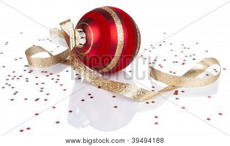 Red Christmas ornament and gold ribbon with reflection