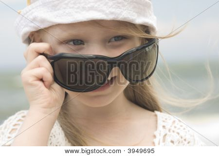 Little Girl And Big Sunglasses
