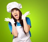 Shock To Woman On Cooking Time On Green Background