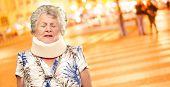 stock photo of neck brace  - A Senior Woman Wearing A Neck brace - JPG
