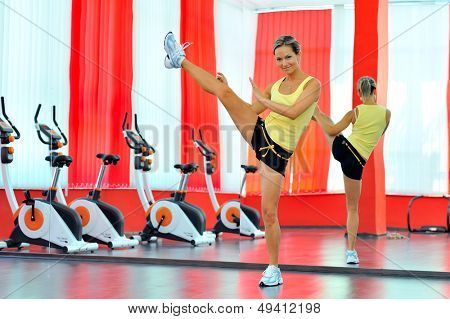 young woman doing exercises in the gym