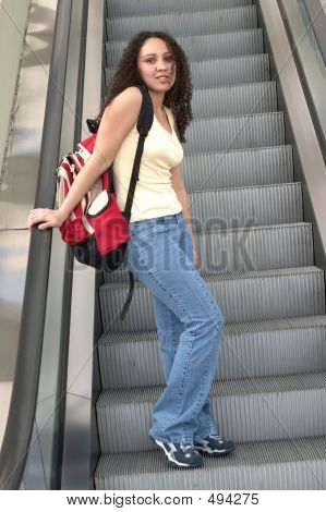 Young Latina Student On Escalator