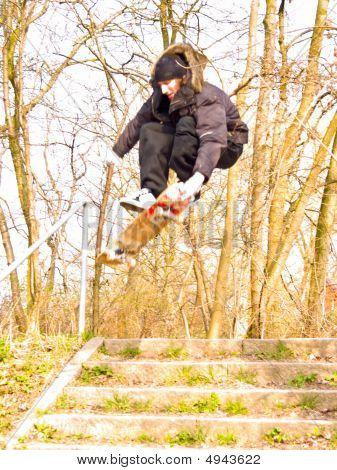 Urban Lifestyle - Young Male Skater Getting Some Air