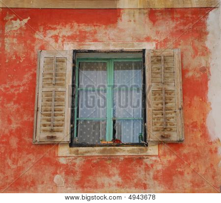 Brown Shutters In Red Wall, Izola