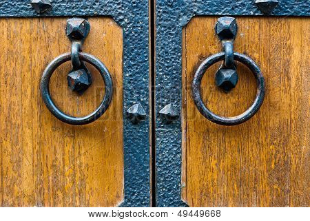 Closeup Of Wooden Door With Metal Door Handle.