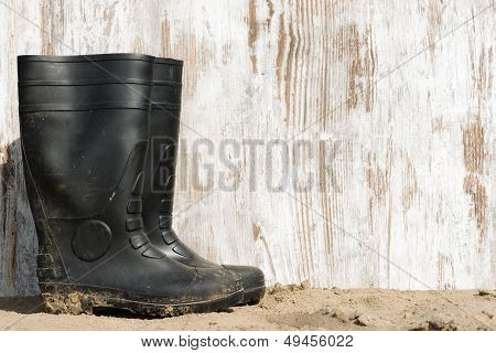 Rubber Boots On The Beach