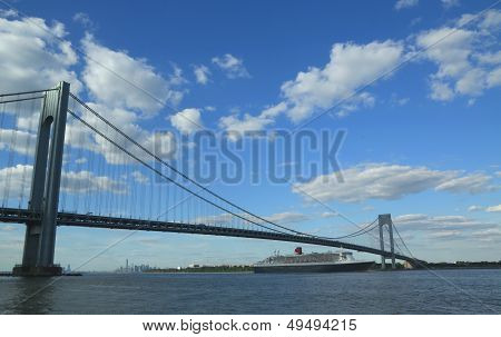Queen Mary 2 cruise ship in New York Harbor under Verrazano Bridge