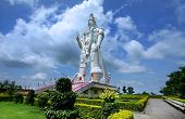 picture of veer  - Huge mighty Hanuman statue against cloudy skies in India - JPG