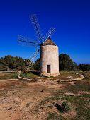 stock photo of mola  - Windmill in el Pilar de la Mola on the island Formentera Balearic Islands Spain - JPG