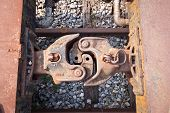 stock photo of boxcar  - Old and rusty train cabins connector taken from top view on sunny day - JPG