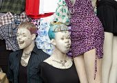stock photo of crotch  - Two mannequin dummies outside a clothing store posed in a funny way - JPG