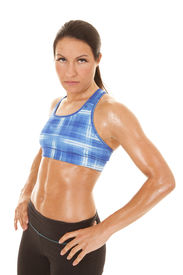 image of halter-top  - A woman in a blue halter top and sweat - JPG