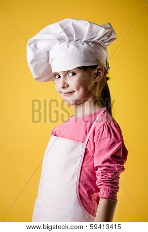 Little girl chef in uniform