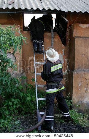 Fireman Spraying Water