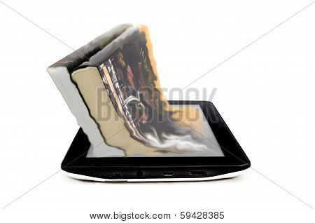 Book and tablet computer on a white background