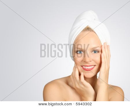 Woman With A Towel On Hair