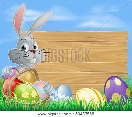 Rabbit With Eggs Basket And Easter Sign