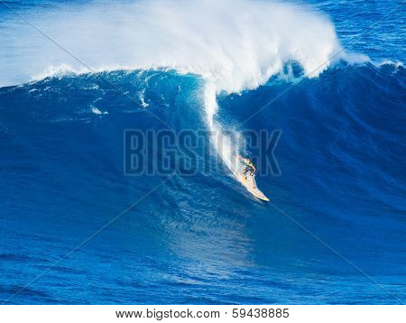 Extreme surfer riding giant wave  in Hawaii, Paddle in big wave surfing