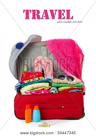 Red travel suitcase with personal belongings isolated on white