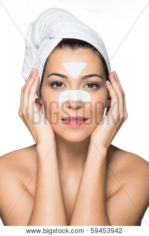 Portrait Of A Young Woman With Clear-Up Patches On The Forehead And nose For remove Blackheads Isolated On White Background