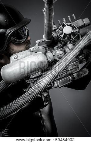 Scifi.Starfighter with huge plasma rifle, fantasy concept, military helmet and goggles motorcyclist