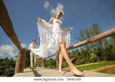 Newlyweds On Wooden Brige
