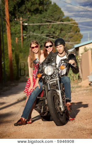 Trio Posing On Motorcycle
