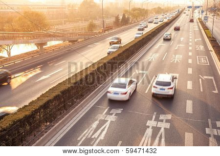 Cars in motion blur on street during sunset,Beijing China