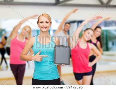 sport, excercise, technology, internet and healthcare - sporty woman with tablet pc blank screen