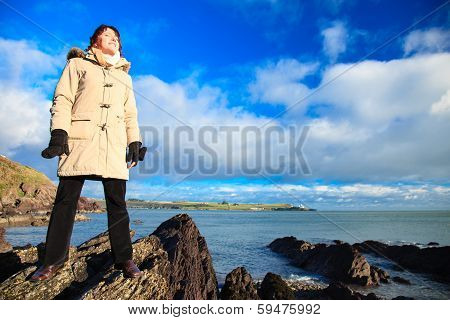 Woman Standing On Rock Cliff At Ocean, Relaxing Co. Cork Ireland