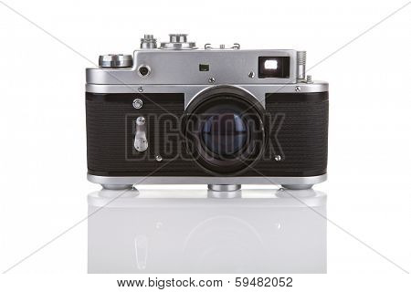 Old manual camera on white background with reflection