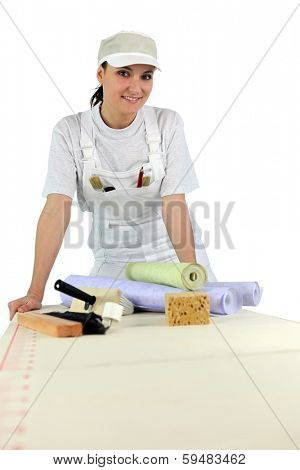 Woman ready to wallpaper