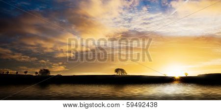 Sunrise Silhouette Over Water
