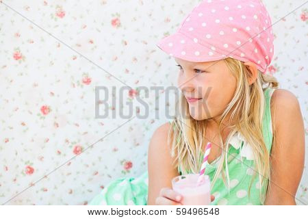 Smiling Young Girl Holding Smoothie Drink