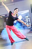 stock photo of zumba  - young woman in sport dress at an aerobic and zumba exercise