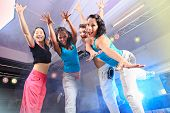 picture of zumba  - young women in sport dress jumping at an aerobic and zumba exercise