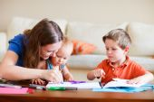 picture of daycare  - Young mother and her two kids drawing together - JPG