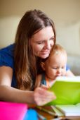 picture of daycare  - Young mother and her baby daughter reading together - JPG