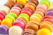 picture of french pastry  - traditional french colorful macarons in a rows in a box - JPG