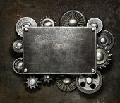 foto of cogwheel  - Industrial dark metal background - JPG