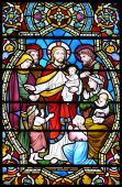 stock photo of stained glass  - Historical biblical stained glass window showing jesus and children - JPG