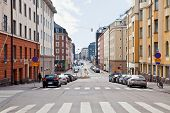 stock photo of municipal  - Street machines and facades of houses in city Helsinki - JPG