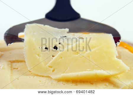 Closeup of cheese with slicer