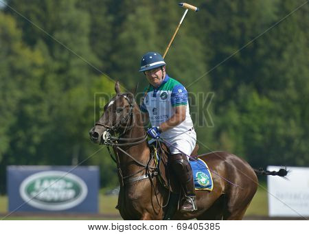 TSELEEVO, MOSCOW REGION, RUSSIA - JULY 26, 2014: Alexis Rodzianko of Moscow Polo Club in the match against the team of British Schools during the British Polo Day. Moscow Polo Club won 7-6