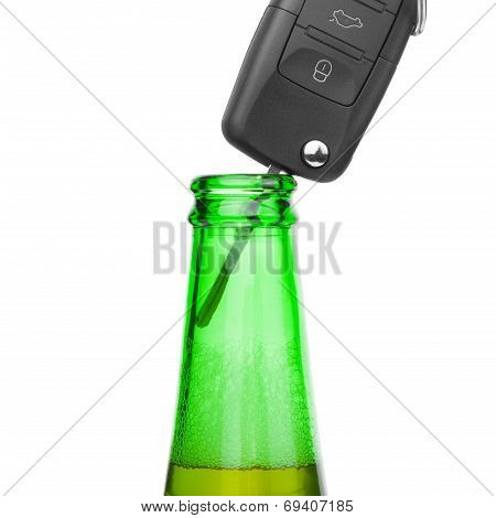 Car Key In Neck Of Bottle Of Bee - Studio Shot Over White