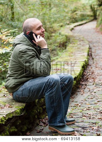 Man Talking On A Mobile In Nature
